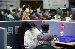 New virus cases in 300s for 2nd day; vaccinations in higher gear