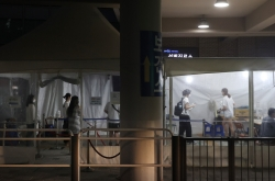 New cases most since late Dec., virus curbs extended for 1 week