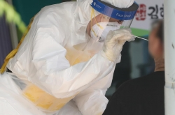 New cases over 1,700 for 2nd day, toughest virus curbs likely to be extended again