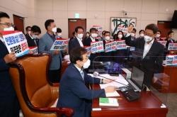 [News Focus] Controversial 'fake news' bill draws closer to legislation