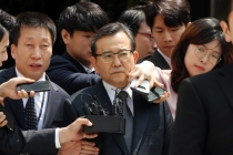 Ex-vice minister mired in orgy scandal cleared of all charges