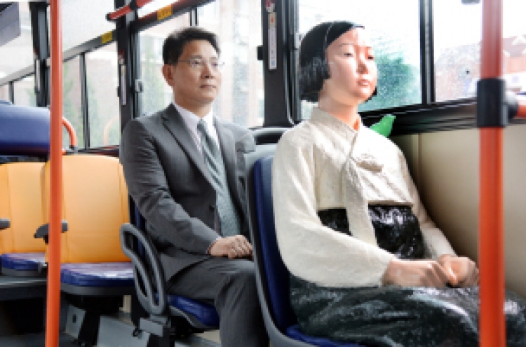 How comfort women statues got to ride Seoul buses