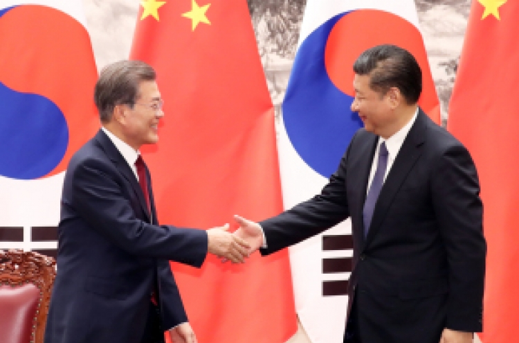 Moon, Xi vow no war on Korean Peninsula
