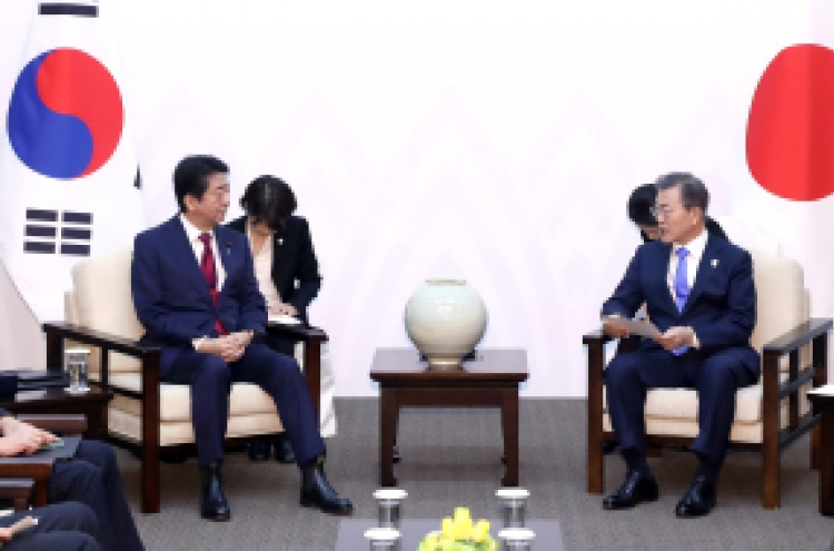 Moon, Abe confirm differences on comfort women, NK in summit