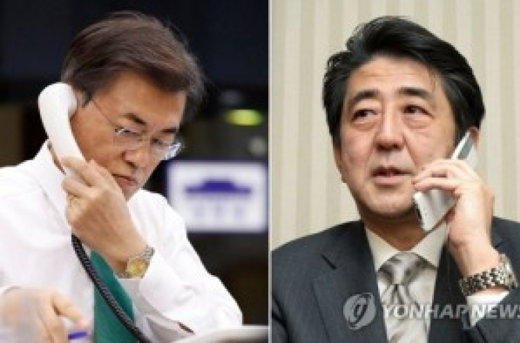 Abe wishes talks with NK during phone meeting with Moon