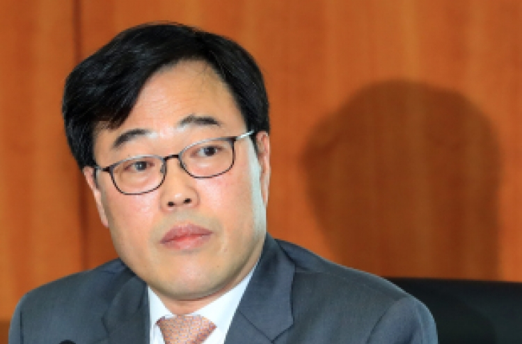 Prosecutors raid stock exchange, bank in probe into FSS chief's sponsored trips