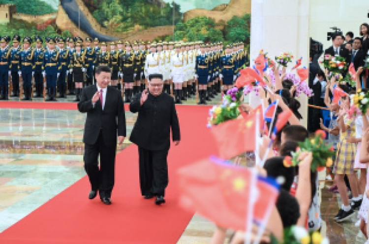 Kim, Xi discuss denuclearization, pledge closer cooperation