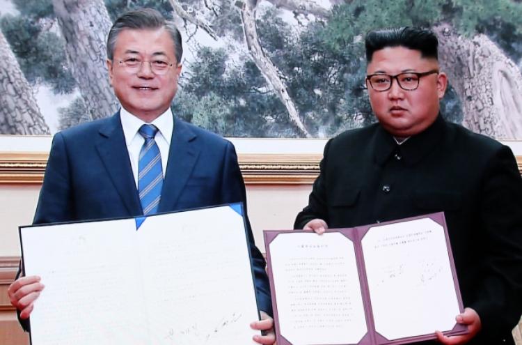 Kim vows to visit Seoul, dismantle nuke, missile sites