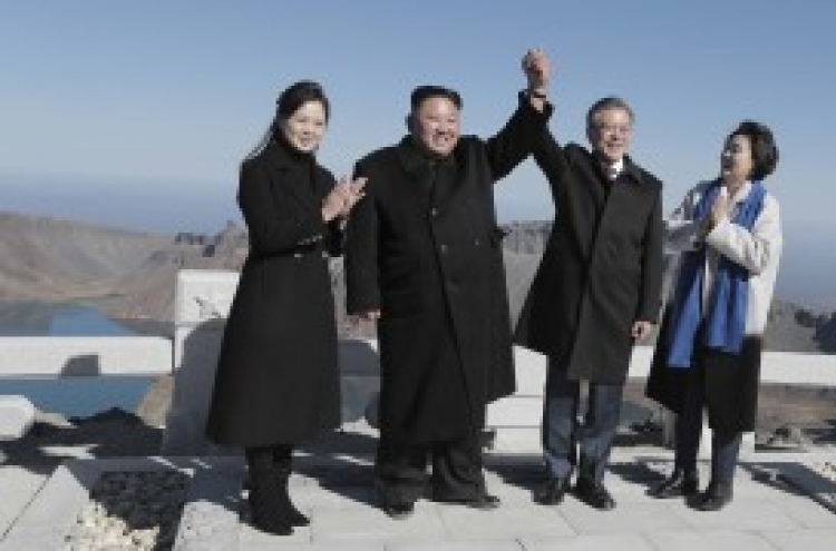 Leaders of two Koreas stand atop 'sacred' Paektusan