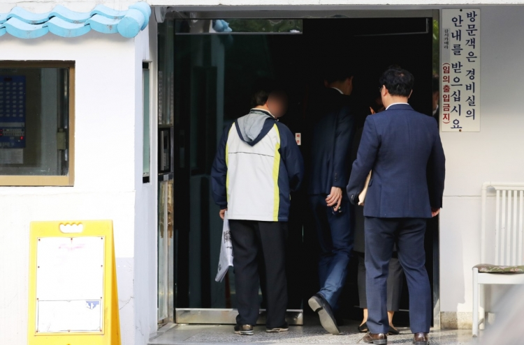 Prosecution raids justice minister's house over corruption scandal