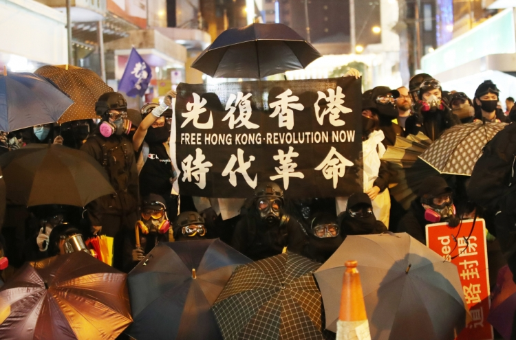 Hong Kongers mark half a year of protest with mammoth rally
