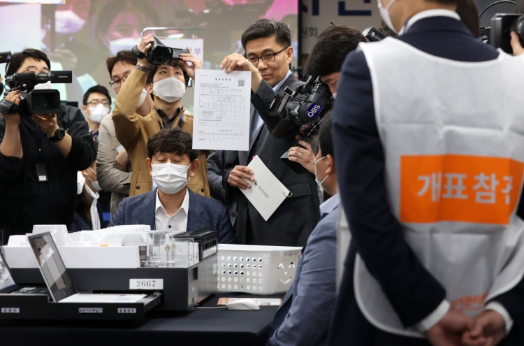 Election watchdog demonstrates ballot-counting process to dispel 'rigging' claims