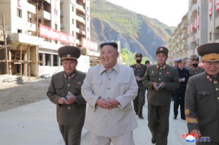 NK's Kim visits typhoon-hit village, pledges 25,000 new homes