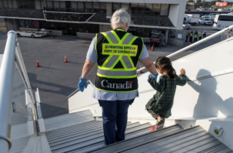Canada halts Afghanistan evacuations as deadline looms
