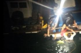 Woman falls into sea while staring at phone