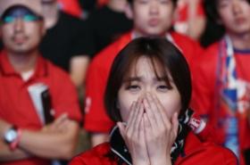 Korean soccer fans react to loss against Sweden
