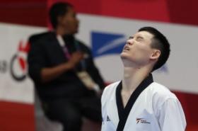 Taekwondo poomsae practitioner Kang Min-sung wins S. Korea's 1st gold