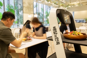 Mobile orders and unmanned serving: Robot restaurant lands in Seoul
