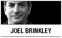 [Joel Brinkley] A temple and a tempest at the border