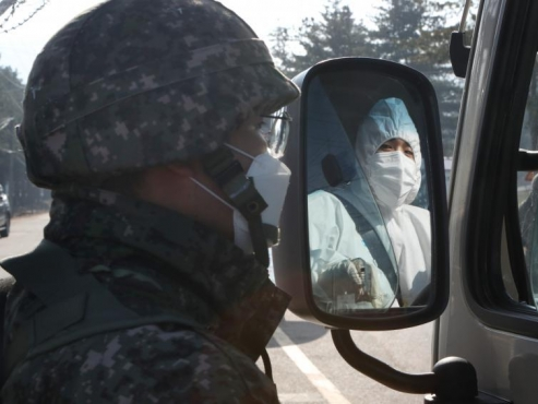 Military bans troops from vacationing, off-base trips over resurgent virus
