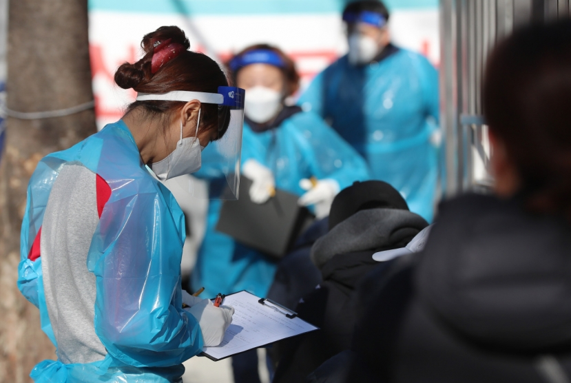 New virus cases below 600, bigger wave of pandemic in progress