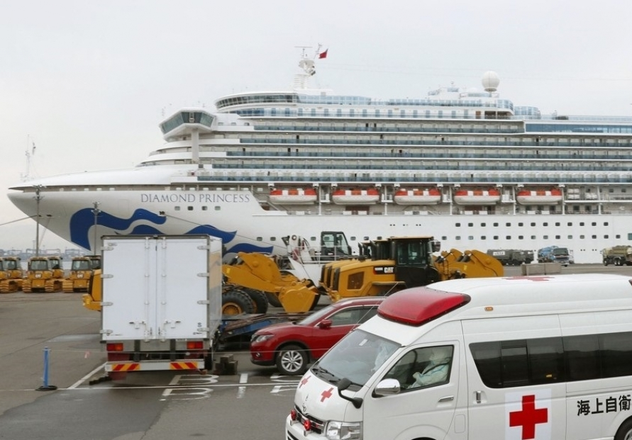 Japan confirms 99 more cases of new virus on cruise ship