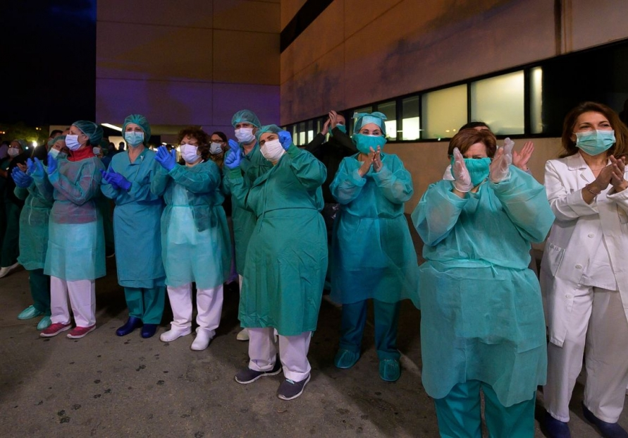 Italy hopes virus is easing but fears new onslaught in south