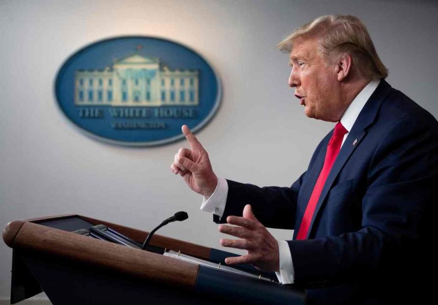 Trump invokes defense powers to order GM to produce ventilators