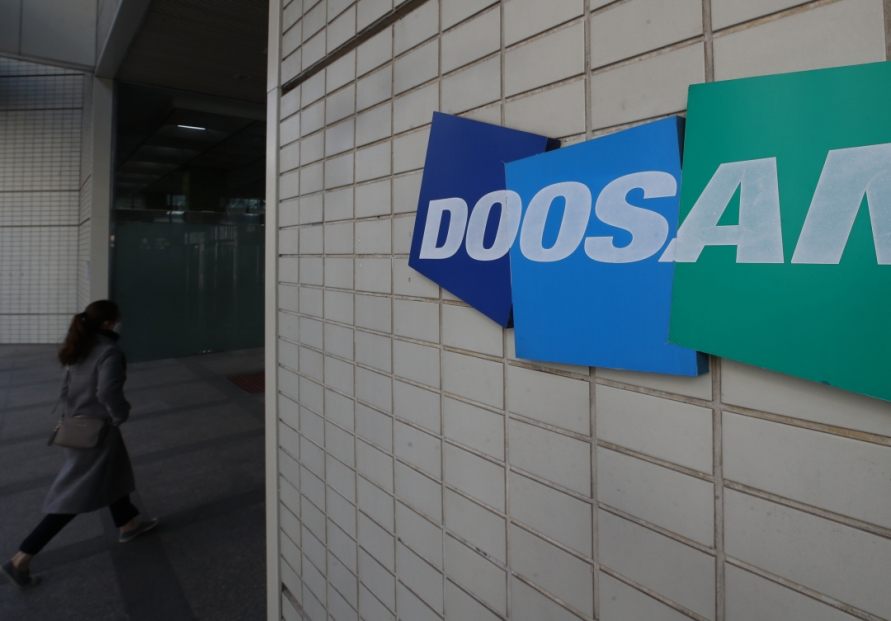 Doosan Group execs to forgo 30% of their wages