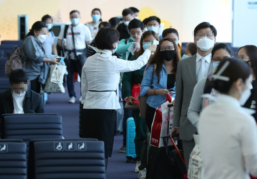 All air travelers required to wear masks from Wednesday