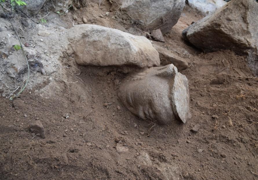 Missing head of Buddha statue on Namsan in Gyeongju discovered