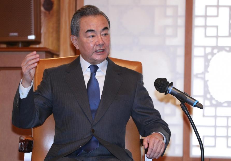 Wang stresses two Koreas should determine peninsula's fate