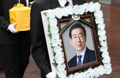Seoul mayor laid to rest amid lingering controversy