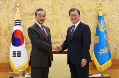 Wang Yi says Xi visit requires 'complete control' of COVID-19