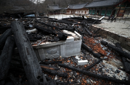 Historic Buddhist temple destroyed in suspected arson attack