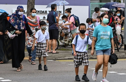 Singapore shuts schools, Taiwan bars foreigners to battle outbreaks