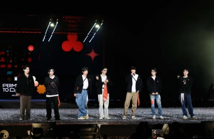 [Herald Review] BTS embraces vulnerability, connects with fans in 'PTD On Stage'