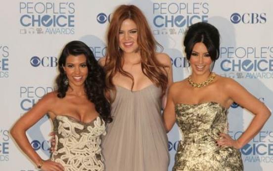 Kardashian sisters sued over debit card debacle