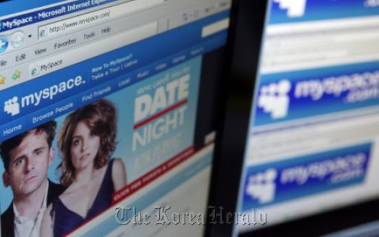 MySpace cuts nearly half its global staff