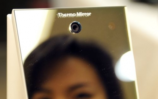 Japanese firm invents mirror to spot the flu