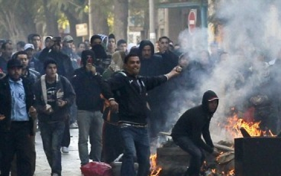 Unrest engulfs Tunisia after president flees