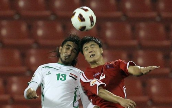 Iraq trips N. Korea to reach quarters