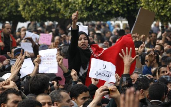 Tunisian leader vows 'break' with old regime