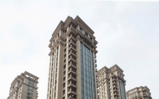 China unveils new steps to cool property market