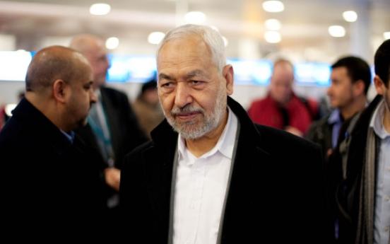Tunisians greet Islamist leader's return
