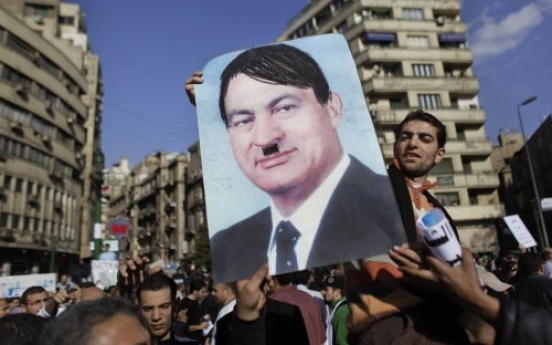 A portrait of Mubarak with moustache and hair to represent Hitler