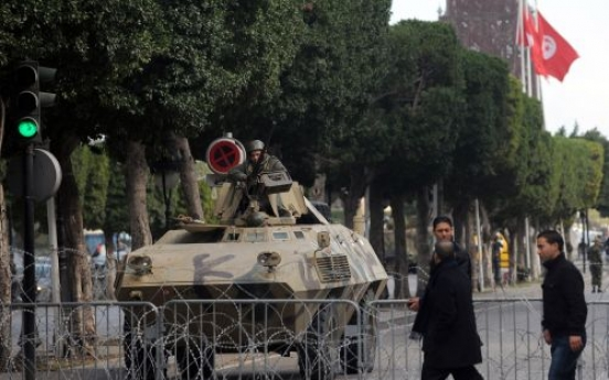 Tunisian police fire on crowd