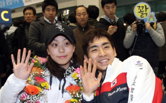 Korean athletes return home