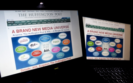 AOL steps up news, ad push with Huffington Post