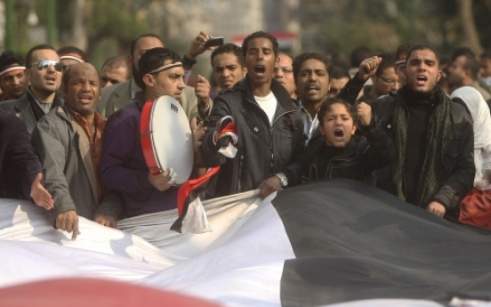 Egypt regime warns of crackdown as revolt spreads